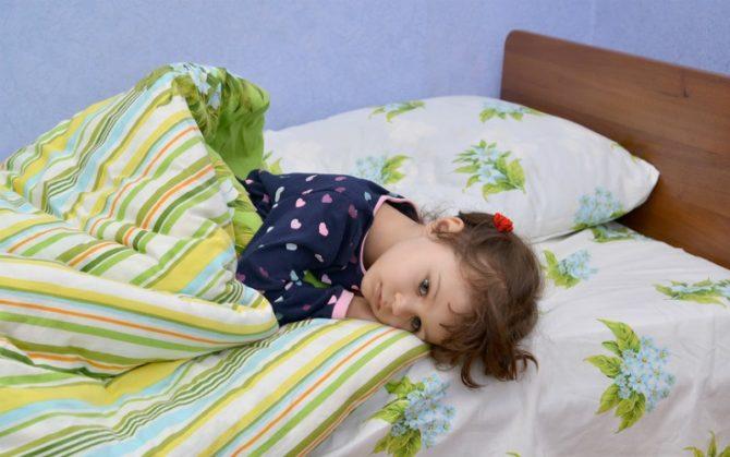 Ребёнок в постели